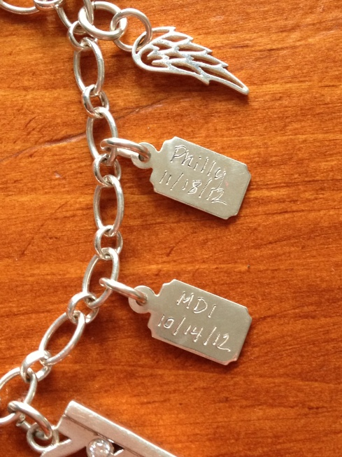 close up running charm bracelet