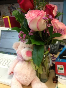 Derek sent me flowers at work for my birthday! Total surprise! Hiding the bear from Chuie.